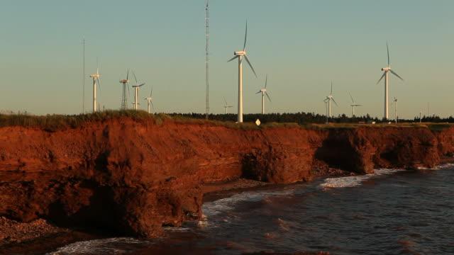 wind turbines at sunset - wind turbine stock videos & royalty-free footage