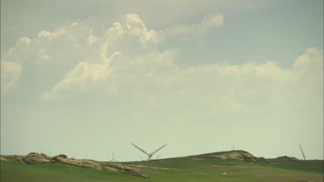 WS Wind turbines behind ridge of hill, Huitengxile, Inner Mongolia, China
