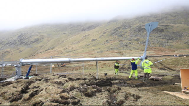 3 wind turbines being constructed behind the kirkstone pass inn on kirkstone pass in the lake district, uk. - permission concept stock videos & royalty-free footage