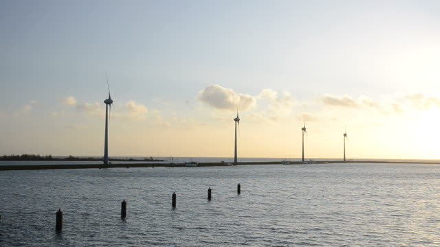 wind turbines during sunset - power in nature stock videos and b-roll footage