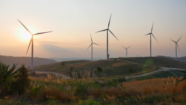 wind turbines farm at sunset - wind turbine stock videos & royalty-free footage