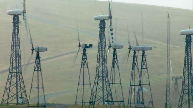 Wind Turbines Generate Energy At Wind Farm