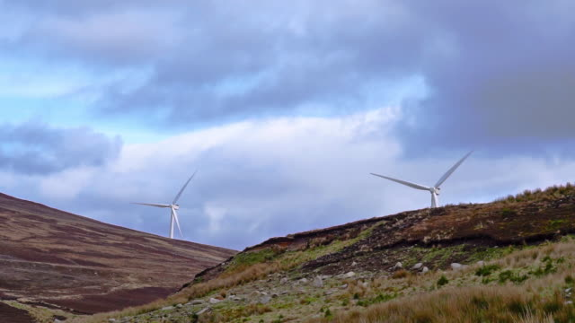 wind turbines generating clean renewable energy - carbon footprint stock videos and b-roll footage