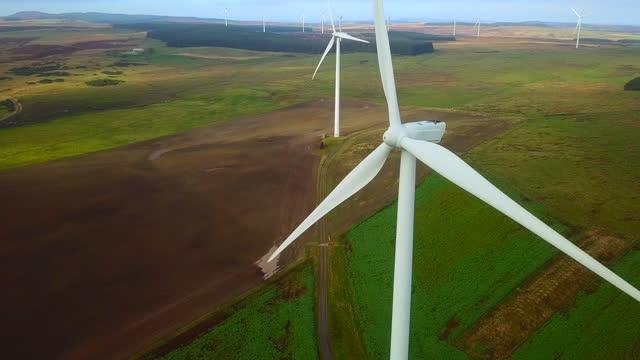 wind turbines generating sustainable power - northumberland stock videos & royalty-free footage