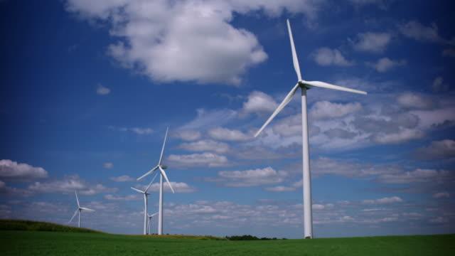 wind turbines in a green field - 風力発電機点の映像素材/bロール