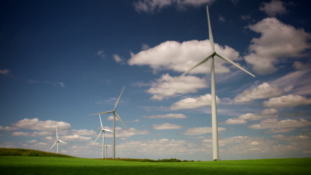wind turbines in a green field - windmill stock videos & royalty-free footage