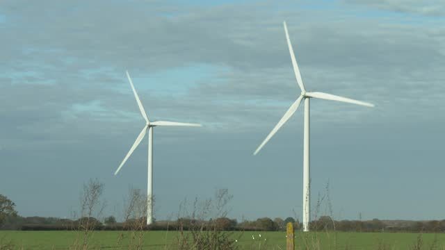 wind turbines in a housing residential area on november 18, 2020 in clacton-on-sea, england. wind energy features prominently in prime minister boris... - turbine stock videos & royalty-free footage