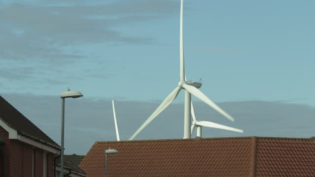 wind turbines in a housing residential area on november 18, 2020 in clacton-on-sea, england. wind energy features prominently in prime minister boris... - wind turbine stock videos & royalty-free footage