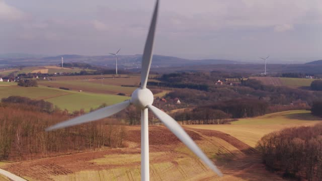 wind turbines in german countryside from the air - energia eolica video stock e b–roll