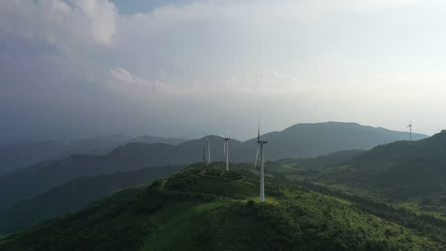 wind turbines in mountain during sunset - generator stock videos & royalty-free footage
