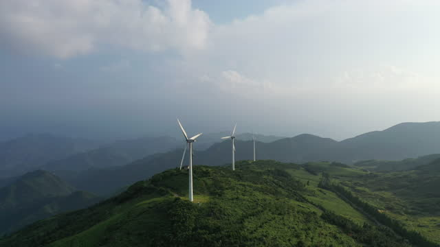 wind turbines in mountain during sunset - propeller stock videos & royalty-free footage