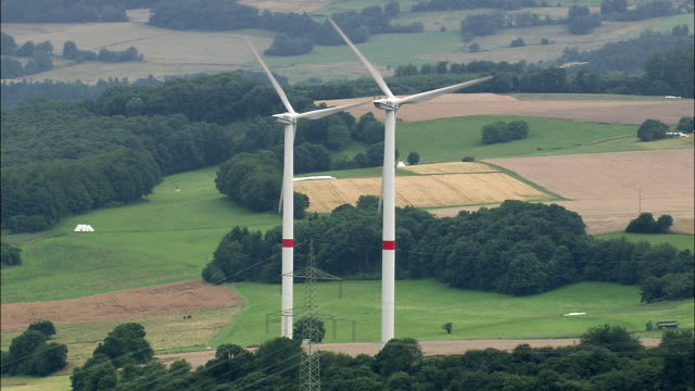 aerial wind turbines in rural landscape, thuringia, germany - turingia video stock e b–roll