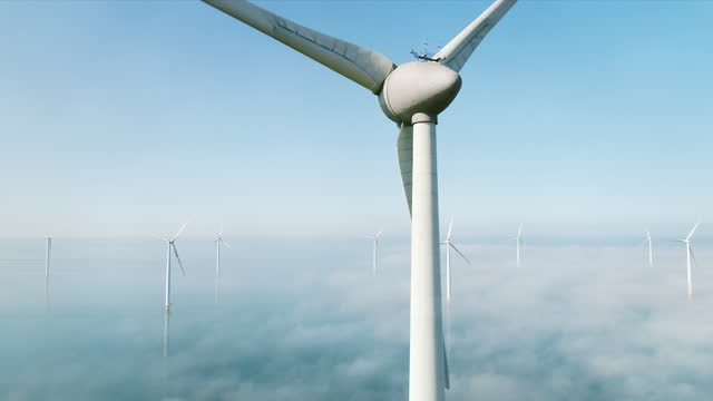 wind turbines in sea covered with clouds,  netherlands - turbine stock videos & royalty-free footage