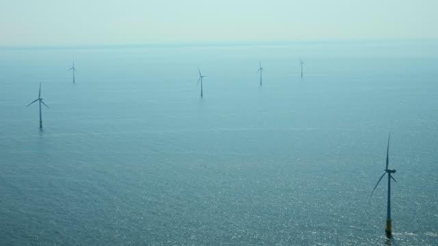 stockvideo's en b-roll-footage met wind turbines in sea - noord holland