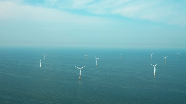 stockvideo's en b-roll-footage met wind turbines in sea - horizon