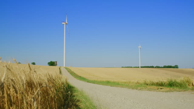 ws wind turbines in the countryside - swaying stock videos & royalty-free footage