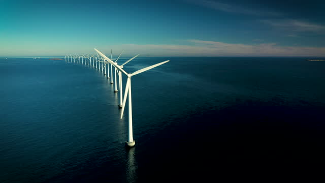 wind turbines in the ocean - sustainable energy stock videos & royalty-free footage
