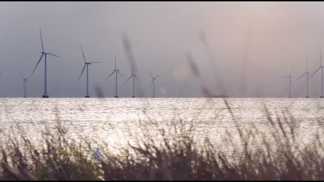 wind turbines in the ocean_4k - turbine stock videos & royalty-free footage