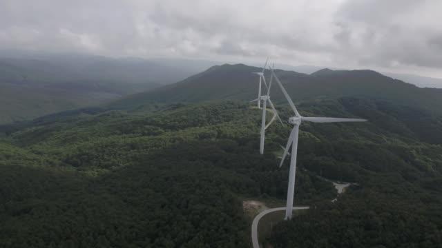 wind turbines in the recreational forest of tohamsan mountain / gyeongju-si, gyeongsangbuk-do, south korea - turbine stock videos & royalty-free footage