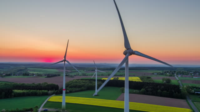 aerial: wind turbines - landscape in twilight - alternative energy stock videos and b-roll footage