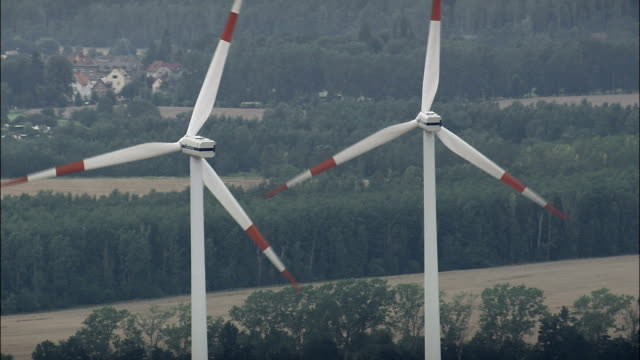 wind turbines near rositz  - aerial view - thuringia,  helicopter filming,  aerial video,  cineflex,  establishing shot,  germany - turingia video stock e b–roll