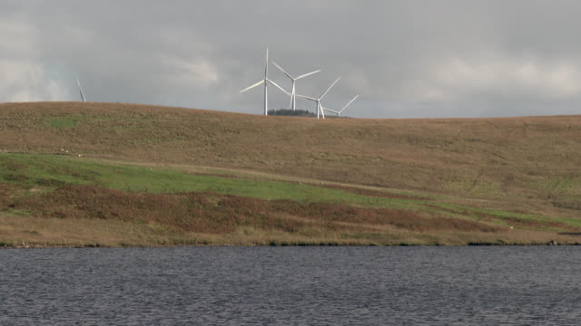 wind turbines next to a scottish loch - johnfscott stock videos & royalty-free footage