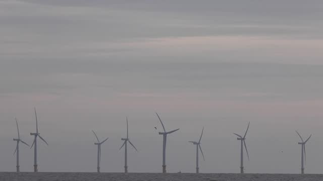 wind turbines off the coast on november 16, 2020 in frinton-on-sea, england. wind energy features prominently in prime minister boris johnson's plan... - wind turbine stock videos & royalty-free footage