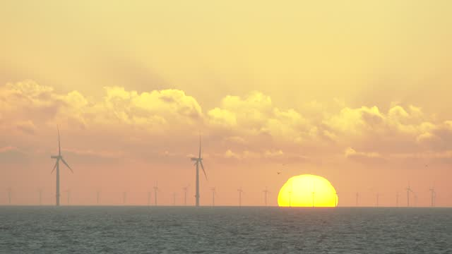 wind turbines off the coast on november 18, 2020 in clacton-on-sea, england. wind energy features prominently in prime minister boris johnson's plan... - environmental conservation stock videos & royalty-free footage