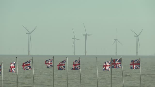 wind turbines off the coast on november 18, 2020 in clacton-on-sea, england. wind energy features prominently in prime minister boris johnson's plan... - turbine stock videos & royalty-free footage