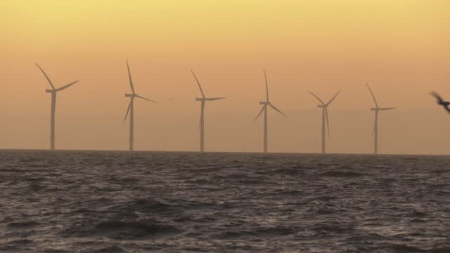 wind turbines off the coast on november 18, 2020 in clacton-on-sea, england. wind energy features prominently in prime minister boris johnson's plan... - video stock videos & royalty-free footage