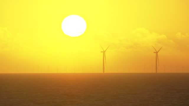 wind turbines off the coast on november 18, 2020 in clacton-on-sea, england. wind energy features prominently in prime minister boris johnson's plan... - wind power stock videos & royalty-free footage