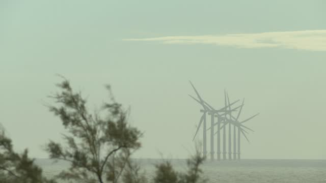 wind turbines off the coast on november 18, 2020 in clacton-on-sea, england. wind energy features prominently in prime minister boris johnson's plan... - fossil fuel stock videos & royalty-free footage