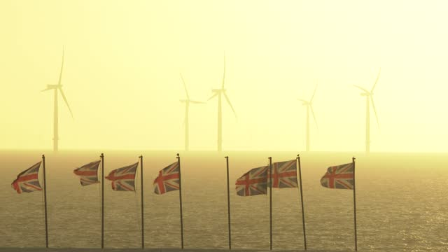 wind turbines off the coast on november 18, 2020 in clacton-on-sea, england. wind energy features prominently in prime minister boris johnson's plan... - wind turbine stock videos & royalty-free footage