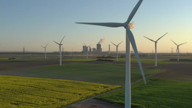 wind turbines on a field (sunset) - innovation stock videos & royalty-free footage