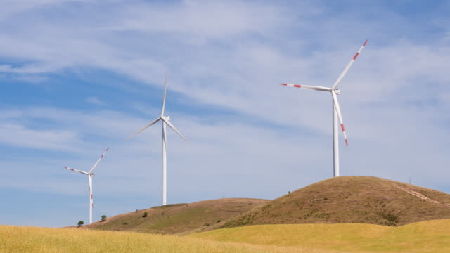 Wind turbines on the hills turning in the wind