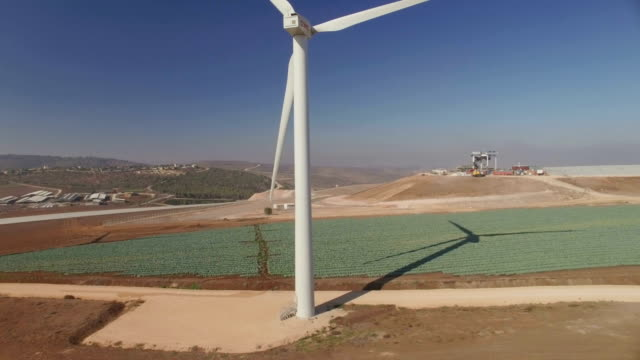 AERIAL : Wind Turbines on top of a hill