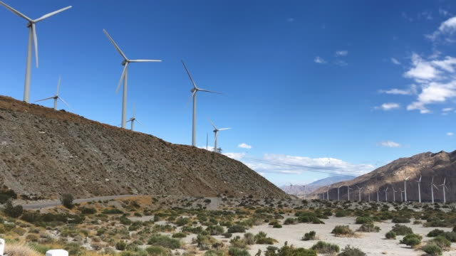 wind turbines operate at a wind farm, a key power source for the coachella valley, on may 6, 2019 in whitewater, california. california's fourth... - palm springs california stock videos & royalty-free footage