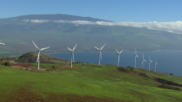 wind turbines overlook the maui coast on the kaheawa wind farm. - medium group of objects stock videos & royalty-free footage