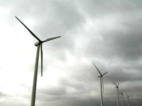 stockvideo's en b-roll-footage met wind turbines producing clean renewable energy - kleine groep dingen