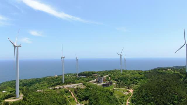 wind turbines producing wind power / yeongdeok-gun, gyeongsangbuk-do, south korea - eco tourism stock videos & royalty-free footage