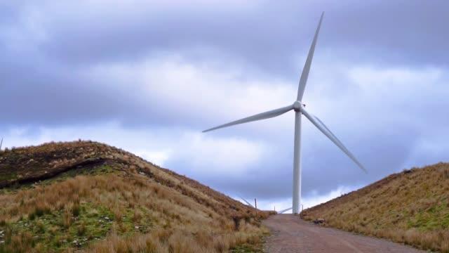 wind turbines renewable energy farm, moy, scotland, panning shot - carbon footprint stock videos and b-roll footage