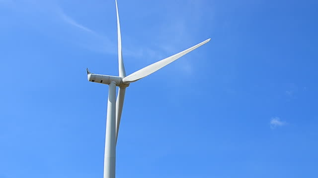 wind turbines rotating in the wind with blue sky backgrounds - full hd format stock videos & royalty-free footage