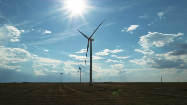 wind turbines rotating on sunny day - kansas stock videos & royalty-free footage
