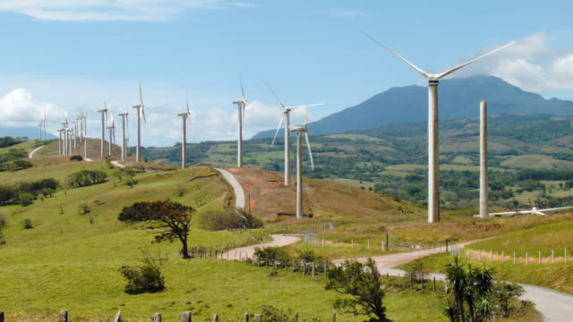 wind turbines run by the costa rican electricity institute are seen along a ridge line as the power company has managed to produce all of the... - コスタリカ点の映像素材/bロール