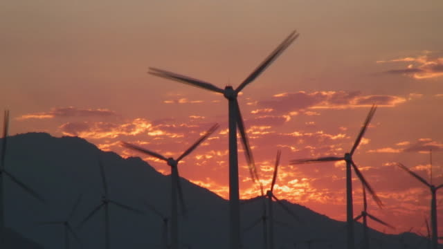 ms wind turbines silhouetted by sunset / palm desert, california, usa - medium group of objects stock videos & royalty-free footage