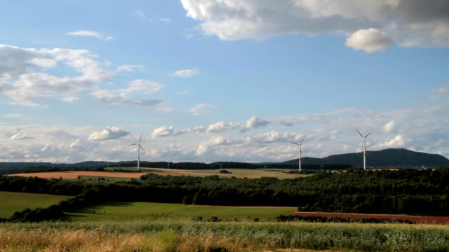Wind turbines spin across the fields of Saarland, Germany.