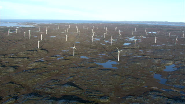 wind turbines spin along the coast of the norwegian sea. available in hd. - norwegian sea stock videos & royalty-free footage