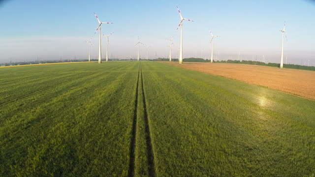 wind turbines spin at a wind farm on may 15, 2015 near brieselang, germany. germany is extricating itself from nuclear energy and raised its goals... - brandenburg state stock videos & royalty-free footage