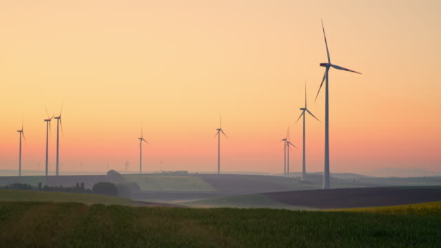ds wind turbines spinning at dawn - turbine stock videos & royalty-free footage