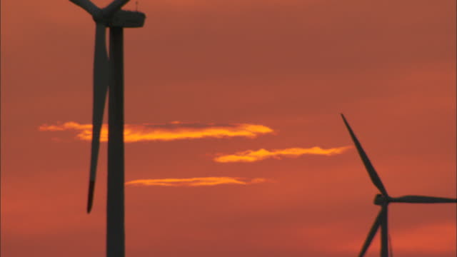 CU Wind turbines turning against sunset sky, Huitengxile, Inner Mongolia, China
